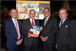Presentation of the anniversary book A Century Radio Holland during the festive celebration of the 100th anniversary of Radio Holland on board of the ss Rotterdam. From left; Paul Smulders (CEO Radio Holland Group), Ing. A. Aboutaleb (Mayor of Rotterdam), Erik van der Noordaa (CEO RH Marine Group) and Ben Vree (Chairman of the supervisory board of RH Marine Group). (Photo: Radio Holland)